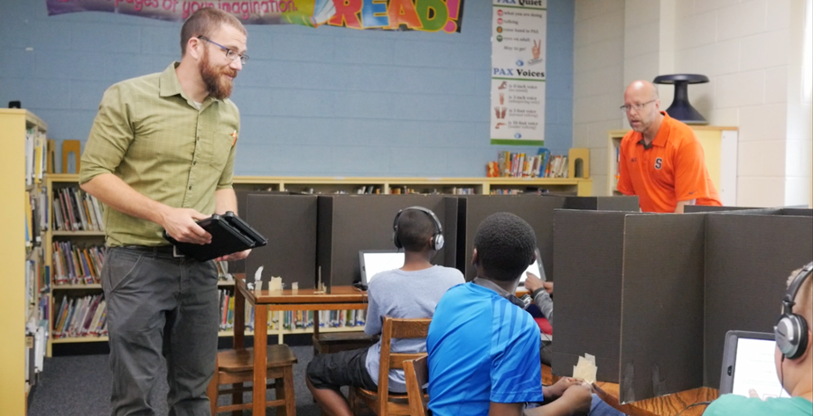 Dr. Felver in a school classroom with students